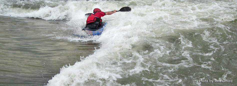 kayak on whitewater feature