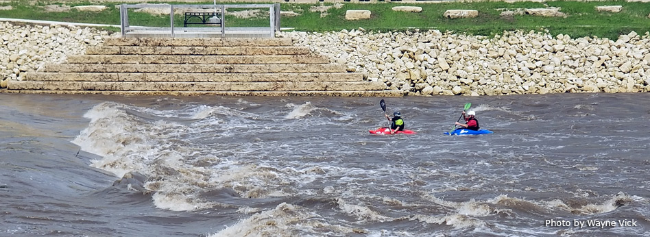 two kayaks on whitewater feature